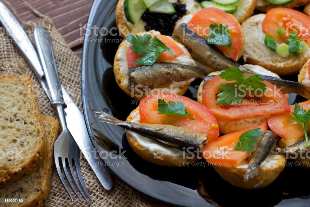 Sandwiches with sprats and tomatoes stock photo