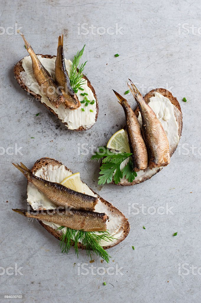 Sandwiches with sprats or sardines stock photo