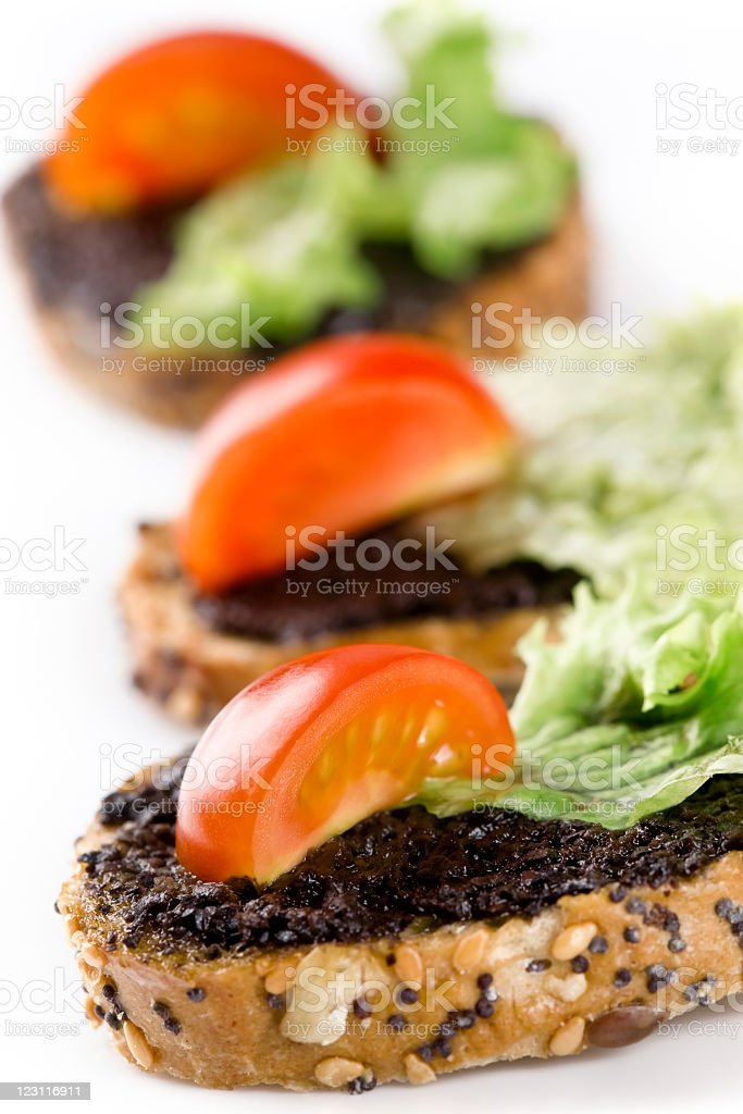 Sandwiches with vegetables and olive paste royalty-free stock photo