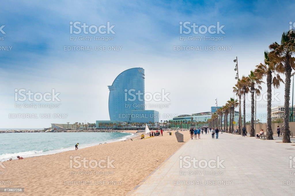 Sandy Barceloneta beach with W hotel on a background stock photo
