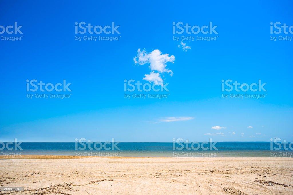 Sandy beach and cloud on blue sky stock photo