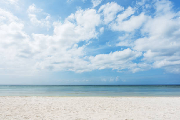 Sandy Beach And Clouds Sky Background Sandy Beach And Clouds Sky Background cloud sky stock pictures, royalty-free photos & images