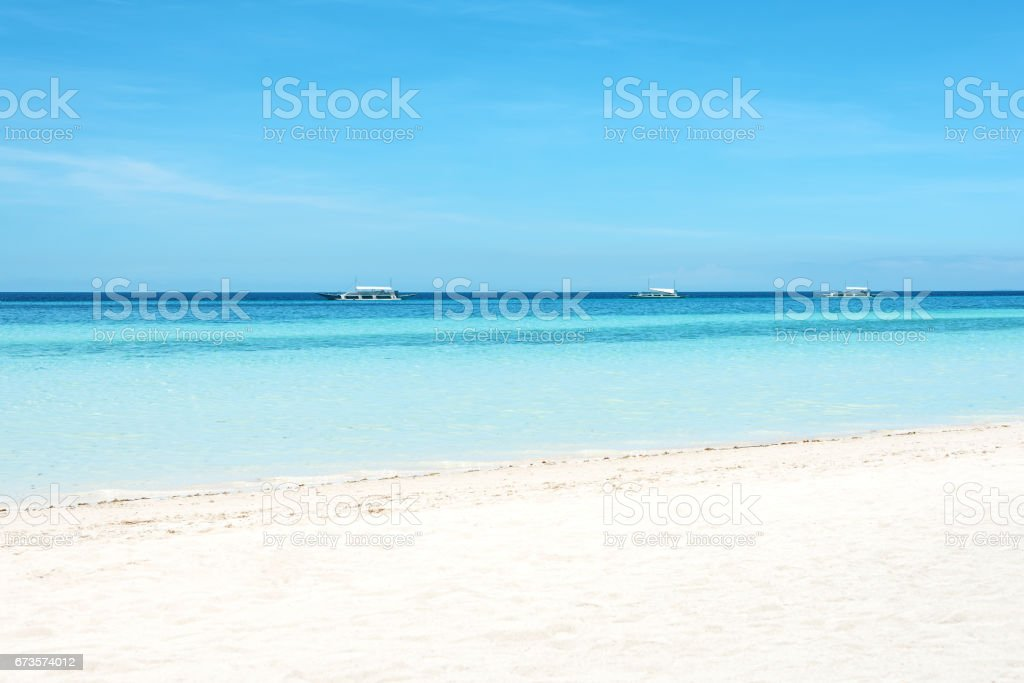 Sandy beach and tropical sea royalty-free stock photo