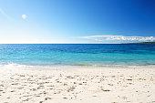 Sandy beach and tropical seascape
