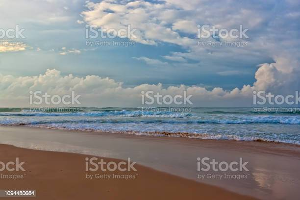 Sandy beach and turquoise ocean waves.