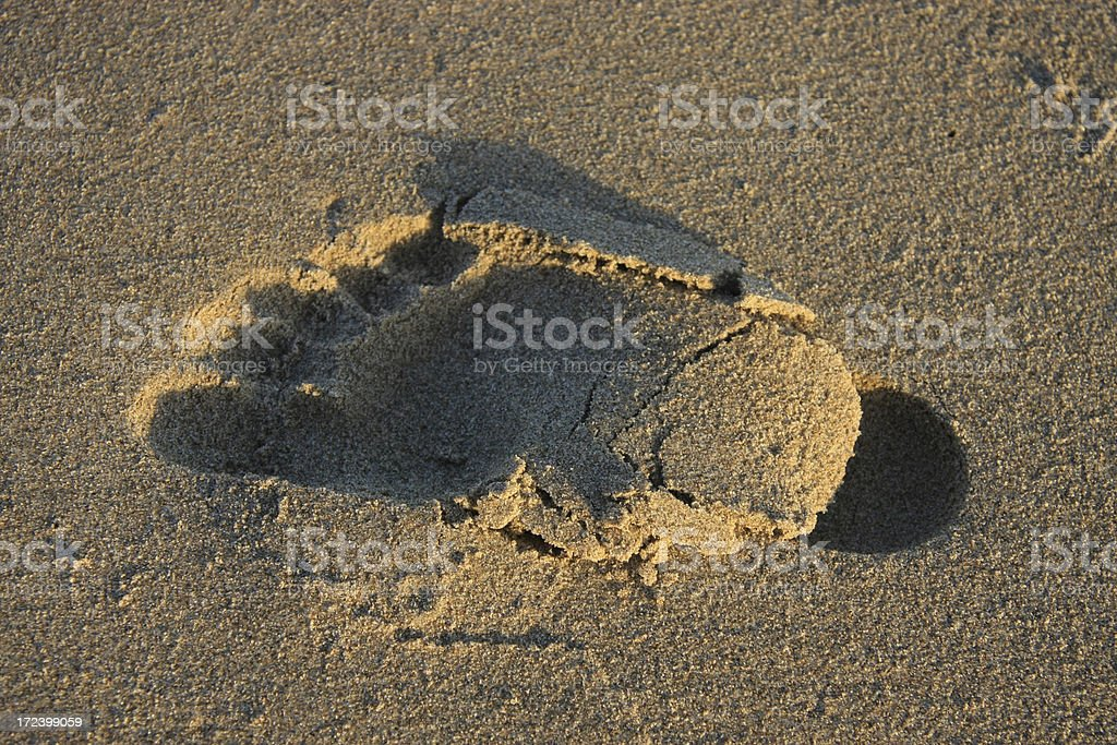 Sandy Beach Footprint at Sunset royalty-free stock photo