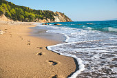 Footprints in the sand on remote (Sissia) beach on Kefalonia island.