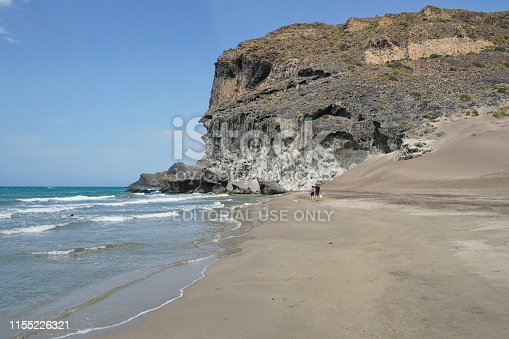 Sandy beach and rocky cliff, Cala Chica in the Cabo de Gata-Níjar natural park, Mediterranean sea, Almeria, Andalusia, Spain