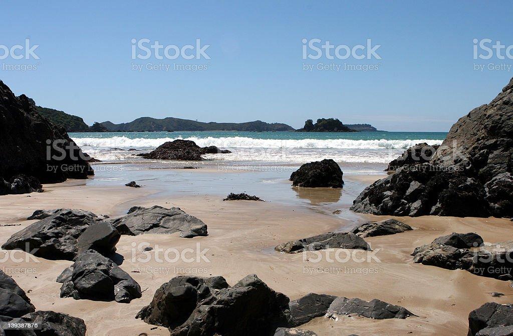 Sandy Beach strewn with rocks royalty-free stock photo