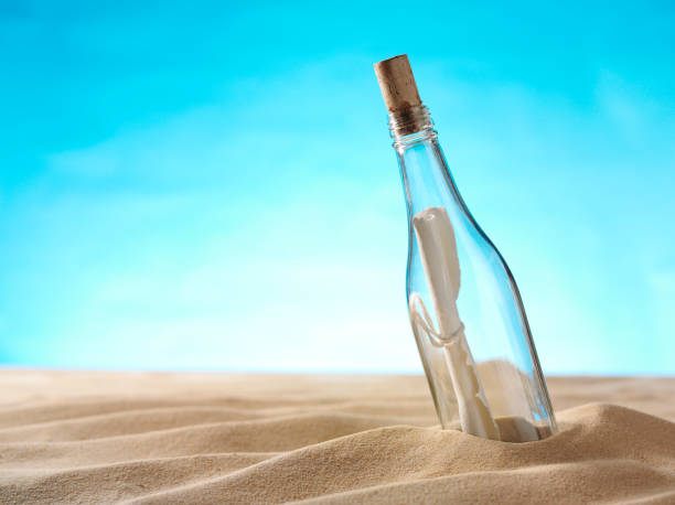 Sandy Beach with a Message in the Bottle stock photo
