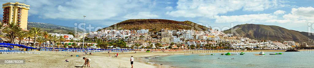 Sandy beach with blue parasols and sunbeds, Los Cristianos stock photo