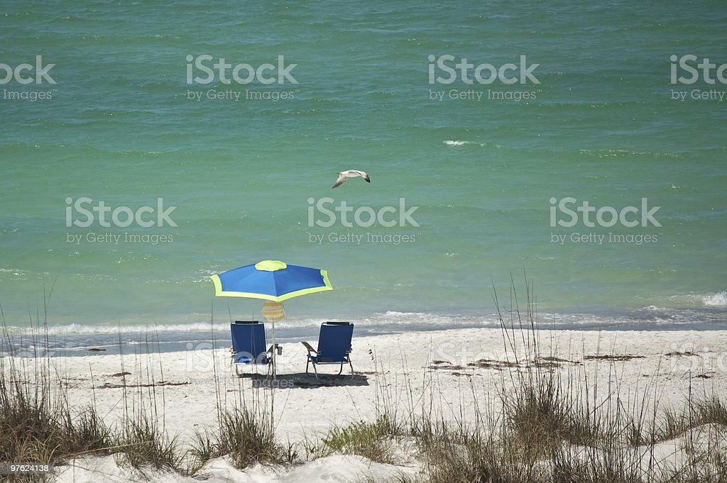 Sandy Beach with Chairs and an Umbrella royalty-free stock photo