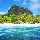 istock Sandy beach with Le Morne Brabant mountain in Mauritius island. 1192448083