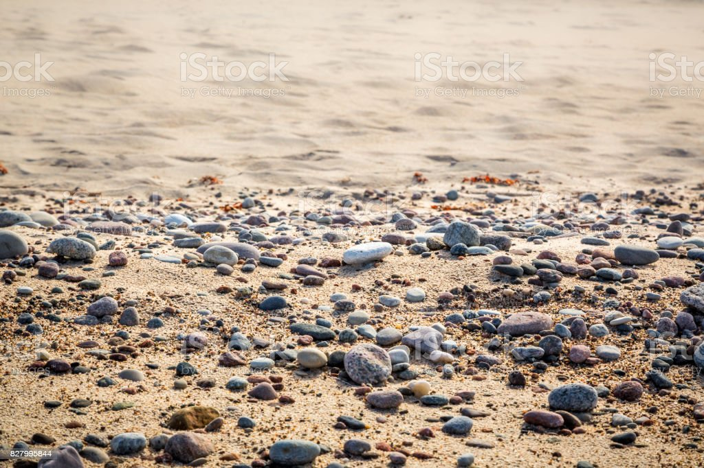 Sandy beach with small pebbles and smoth water, selective focus. royalty-free stock photo