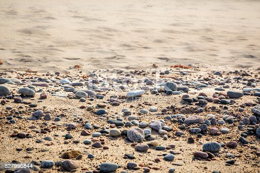 Sandy Beach With Small Pebbles And Smoth Water Selective Focus Stock Photo & More Pictures of Backgrounds