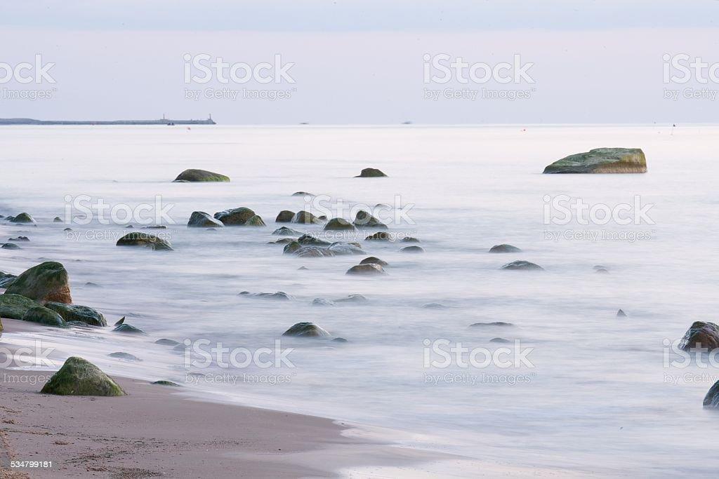Sandy beach with stones stock photo