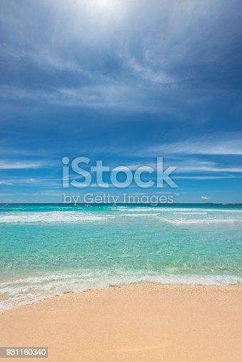 istock Sandy beach with turquoise sea on tropical beach. 931160340