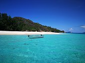 White sandy beaches, turquoise water and majestic cliffs on the  islands of Seychelles - Praslin, Mahe, La Digue.