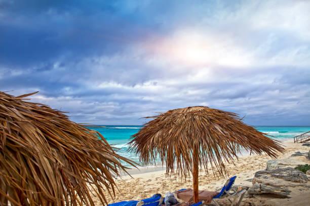 Sandy beaches of the Caribbean Sea and sunshades on Cayo Largo island, Cuba