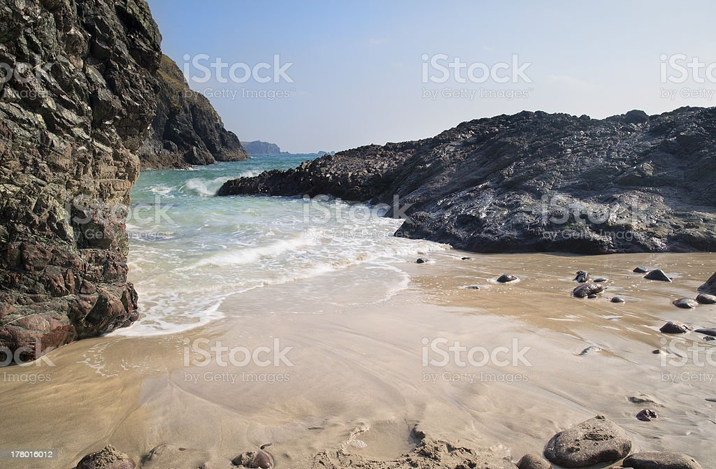 Sandy cove beach with tide coming in royalty-free stock photo