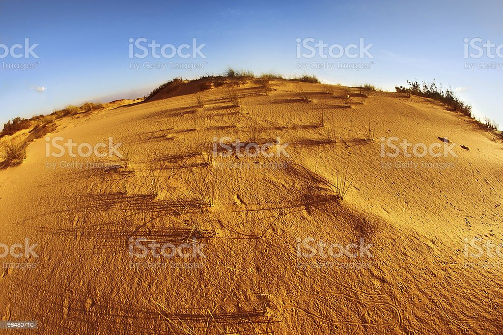 Sandy dunes at Mediterranean sea on a sunset royalty-free stock photo