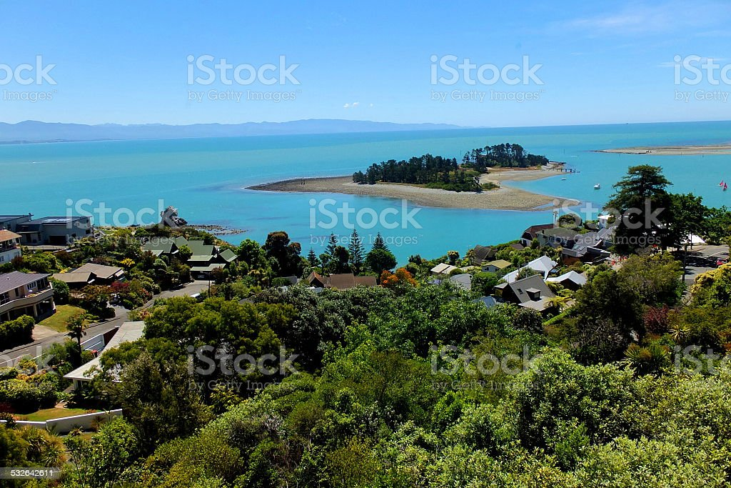 Sandy island and clear blue ocean view from village hill stock photo