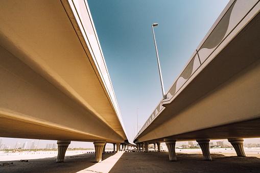 sandy road and bridge in Dubai, UAE
