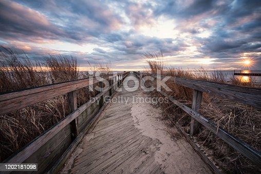 Fishing pier path at sunset in East Islip, NY marina
