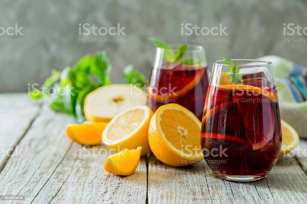 Sangria and ingredients in glasses stock photo
