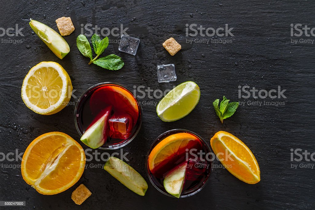 Sangria and ingredients on stone background stock photo