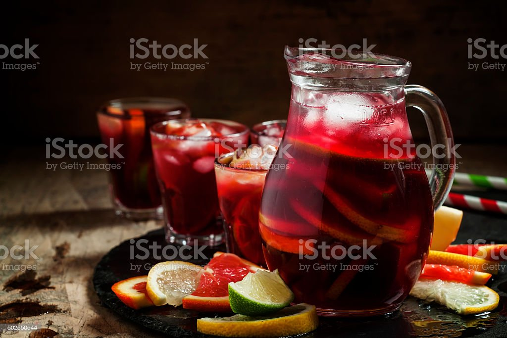 Sangria in pitcher with slices of fruit and ice stock photo