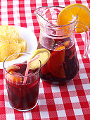 """Sangria"" is a typical Spanish and Portuguese wine punch. Ingredients: red wine, chopped fruit, sweetener, a soft drink, and sometimes a small amount of brandy or any other liquor."