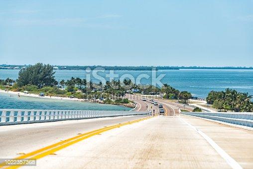Sanibel Island, USA bay during sunny day, toll bridge highway road causeway, turquoise water, cars