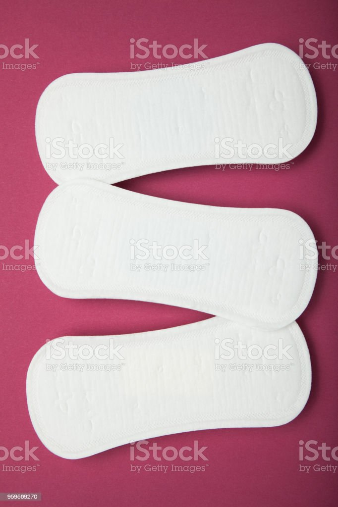 sanitary napkins on a red background stock photo