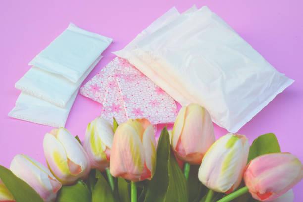 Sanitary napkins, pad (sanitary towel, sanitary pad, menstrual pad) on pink background. stock photo
