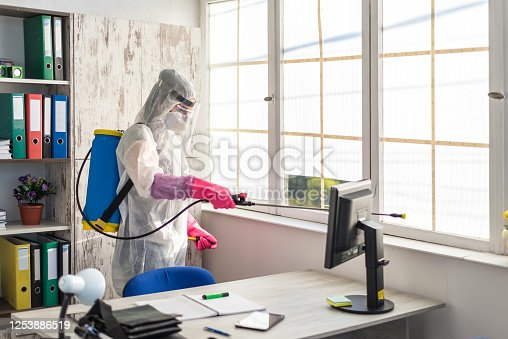 istock A sanitary officer cleans and disinfects an office from Covid 19 1253886519