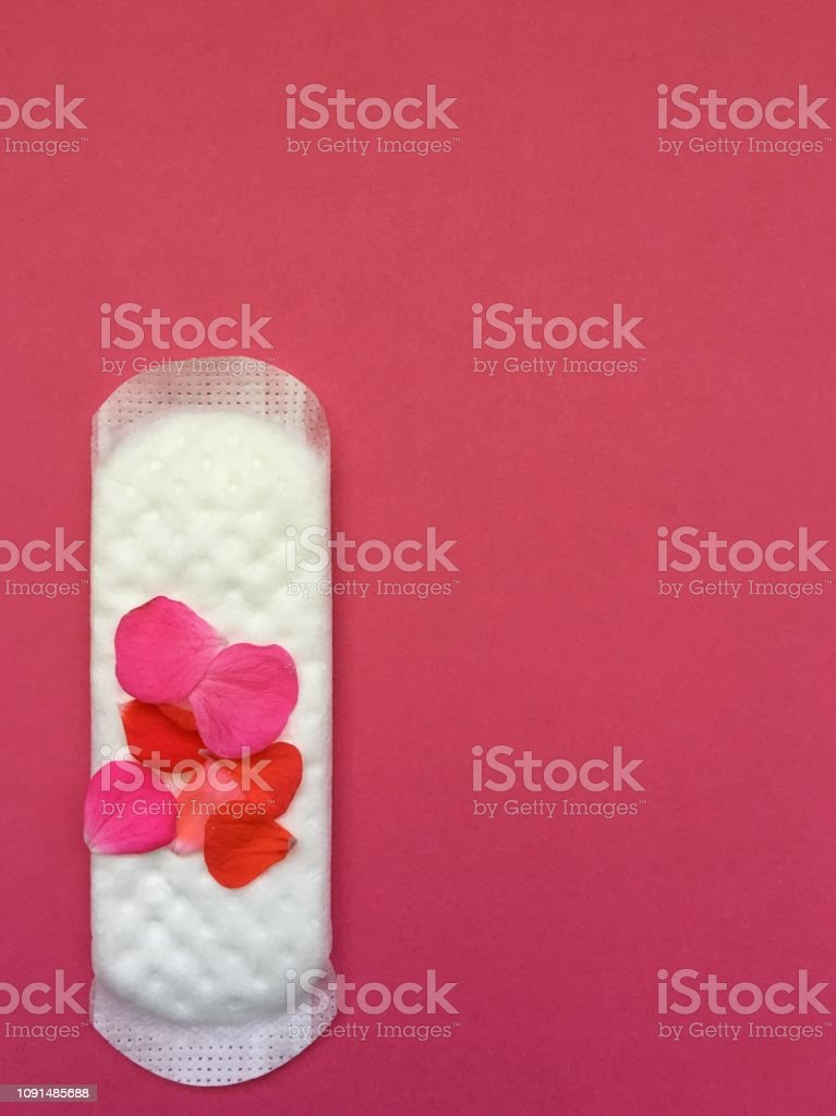 sanitary protection with petals to denote menstruation