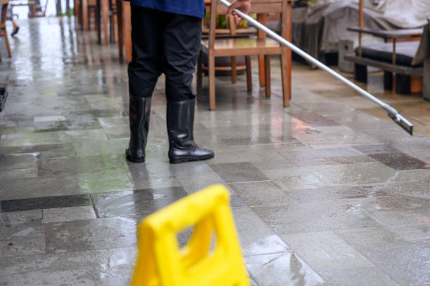 Sanitation worker cleaning pavement stock photo