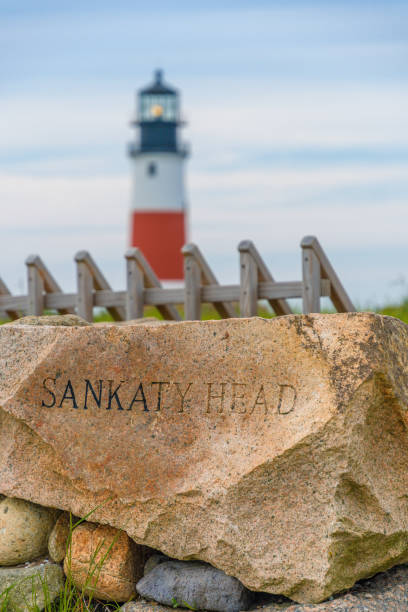 Sankaty Lighthouse with inscripted rock stock photo
