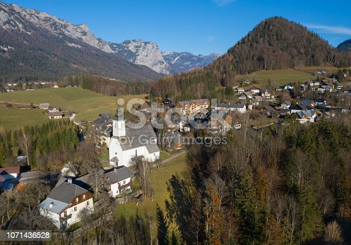 The beautiful Sankt Leonhard Church in middle of the Austrian Alps in the small village Bad Aussee. Aerial. Converted from RAW.