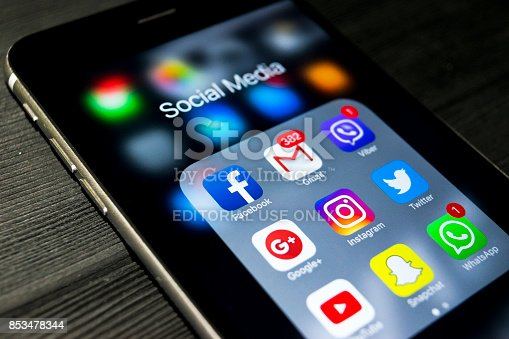 588359078 istock photo Sankt-Petersburg, Russia, September 24, 2017: iphone 6s plus with icons of social media on screen. Smartphone life style smartphone. Starting social media app. 853478344