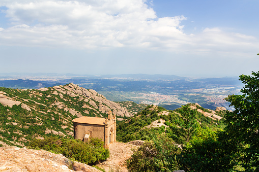 Sant Joan chapel in the mountains of Montserrat Monastery, Catalonia, Barcelona, Spain Sunny day, blue sky