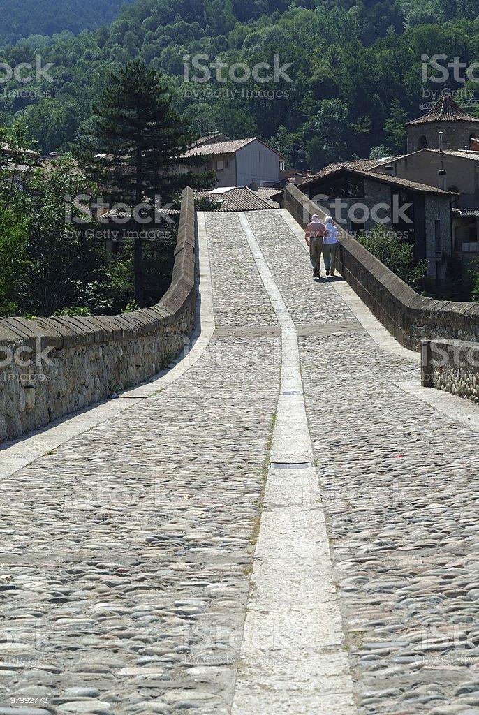 Sant Joan de les Abadesses, Seniors' couple on the bridge royalty-free stock photo