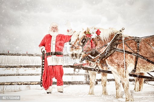 istock Santa and A Team Of Horses In A Snow Storm 621703458