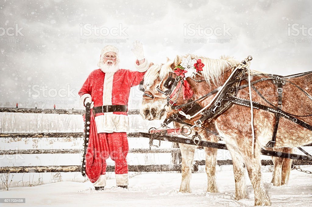 Santa and A Team Of Horses In A Snow Storm stock photo