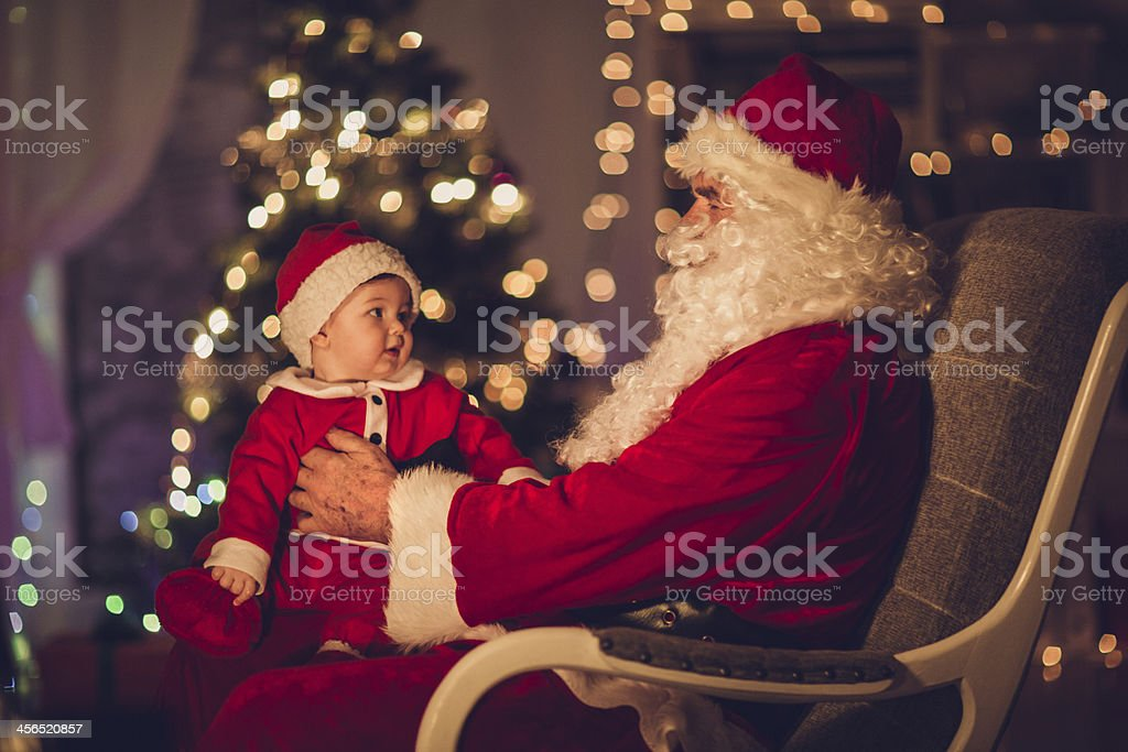 Santa and his little helper stock photo