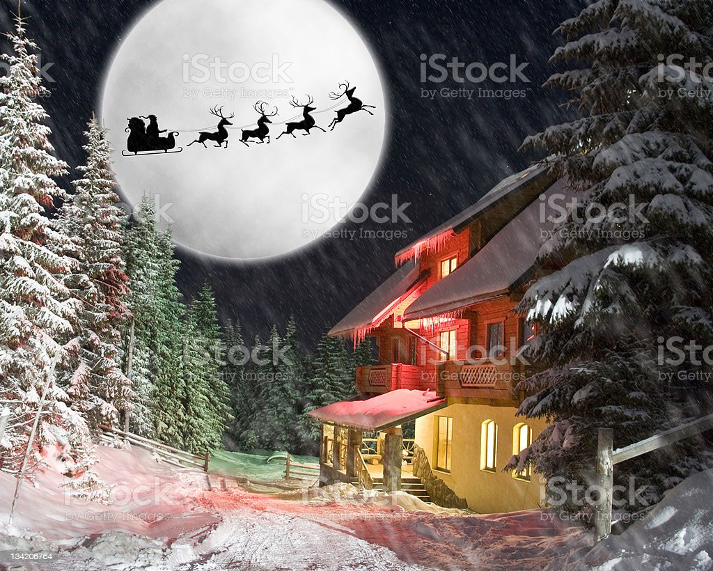 Santa and his reindeers riding against moon stock photo