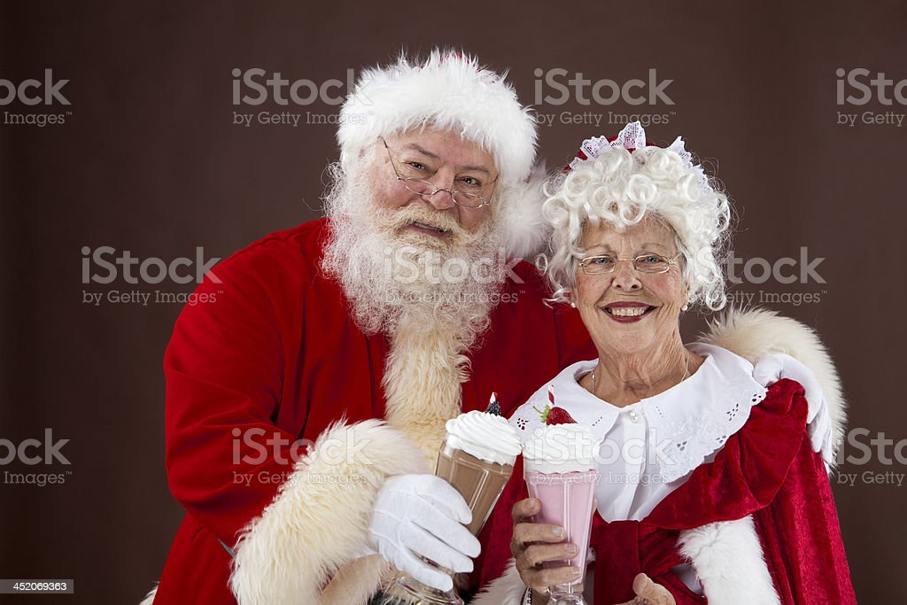 Santa and Mrs Claus drinking milk shakes stock photo