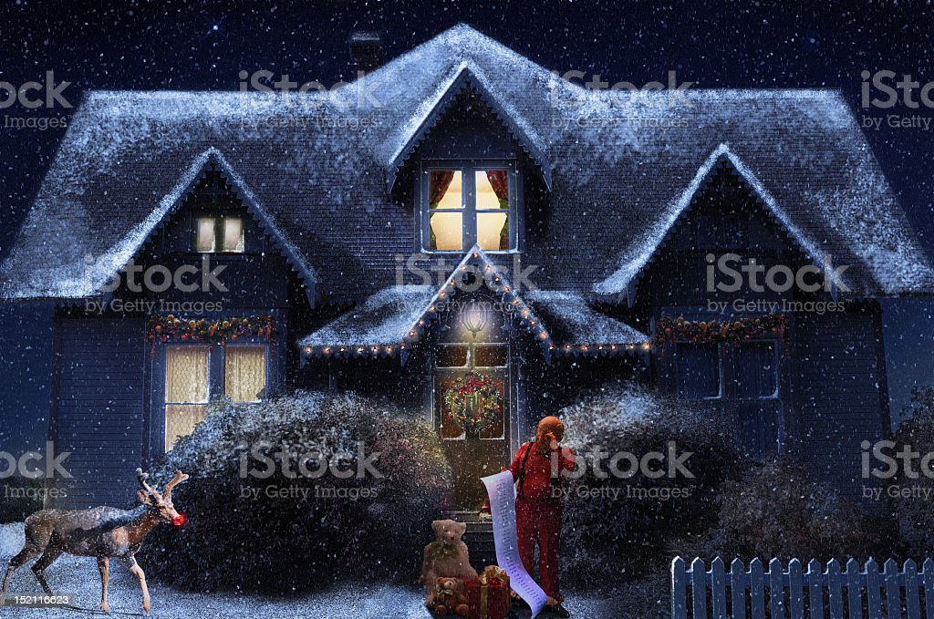 Santa and Rudolph in front of an illustration of a house royalty-free stock photo