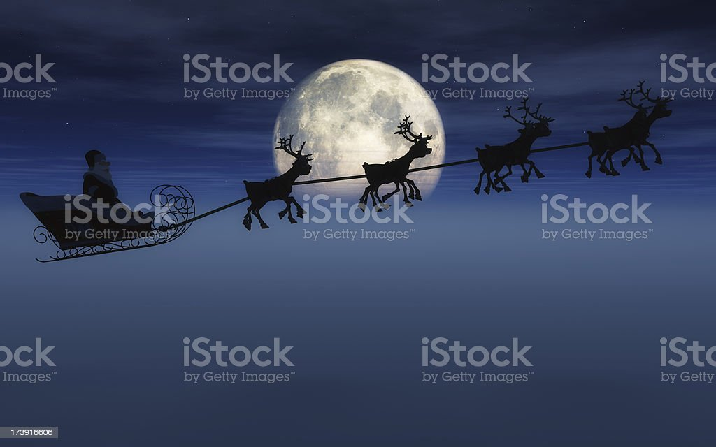 Santa And Sleigh Santa on his sleigh pulled by 8 reindeer in front of a large moon and fog. Celebration Event Stock Photo